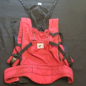 Red and black ergo baby carrier with infant insert